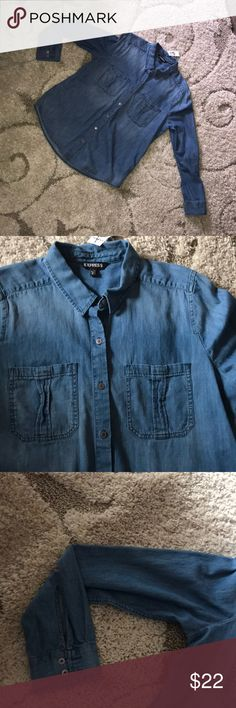 """NWT denim chambray blouse NWT denim chambray top. 100% cotton. Very soft.  Bust measures 21"""" across.  Length is 27"""" from shoulder to hem.  Button down and two chest pocket. Long sleeve with button cuff.   Excellent condition. Express Tops Button Down Shirts"""
