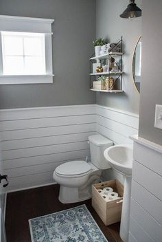Check out this beautiful powder room reveal! This tiny bathroom was transformed … Check out this beautiful powder room reveal! This tiny bathroom was transformed from boring to fresh and modern! I love the shiplap and the modern classic decorations. Half Bathroom Remodel, Bathtub Remodel, Bathroom Renovations, Kitchen Remodel, Bathroom Makeovers, Shower Remodel, Simple Bathroom Makeover, Nautical Bathroom Design Ideas, Nautical Bathrooms