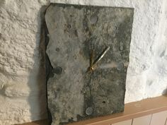 Hand cut reclaimed Cornish Delabole slate clock with engraved indents. Quality German movement requires 1 X AA battery STEVENS