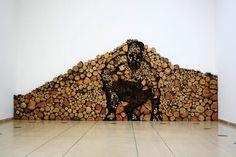 Wooden Art : Crouching Man Hidden in Piles of Wood