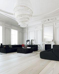 Parisian Apartment- living with large white chandelier and black lounges / Veronika Demovicova and Juraj Talcik