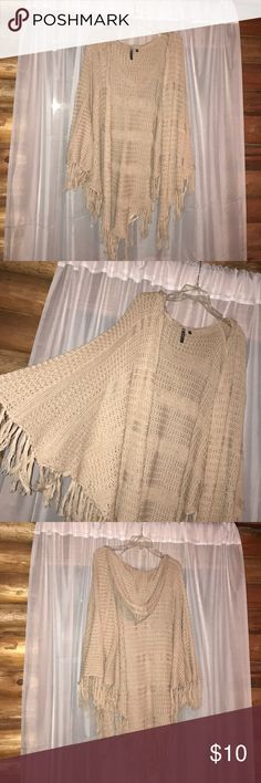 Hooded cardigan Tan hooded cardigan. Has fringe. Long. Warm and very comfortable. Could be worn if you're going for a casual look or a formal look. Sweaters Cardigans