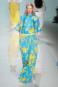 Puglisi went for bold color combinations on floral separates with roomier proportions. Like a blue-and-yellow floral shirt and palazzo, the floral also seen on a trimmer pant suit. When he swapped the blue for a tomato red, the combo may have been just a little too much.  Imaxtree  - HarpersBAZAAR.com
