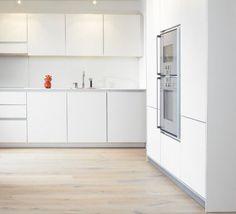 cocina blanca horno alto muebles sin tiradores