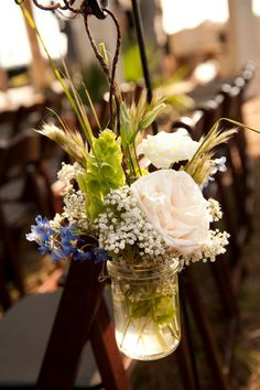 Aisle Markers- hanging mason with garden roses, delphinium, grasses and baby's breath.