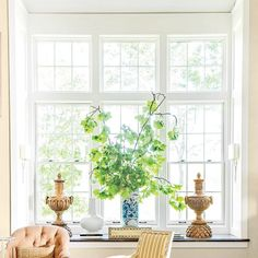 The 2015 Charlottesville Idea House: Using what could serve as a window seat as a table filled with objects turns the windows (and the view) into a focal point.