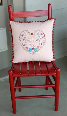 I already had the red chair on my front porch--i just moved it to the front door area. If you don't own a red chair, no problem. Check out local thrift stores for one to paint...easy DIY for Valentine's Day + the color also works for Christmas! #ValentinesDay #holidaydecorating