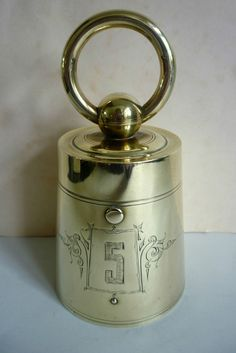 ANTIQUE BRASS DESK INKWELL MODELED AS A WEIGHT 19TH C WEIGHS 725 GRAMS NOVELTY
