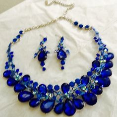 Sapphire Blue Rhinestone Necklace Set This lovely sapphire blue rhinestone necklace and earring set  is classy and sophisticated...the perfect touch to spice up your evening wear!.  Item is new and comes gift boxed. Jewelry Necklaces