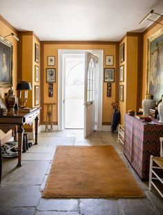 Traditional pieces with fine art and furnishings strike a soulful balance in the hallway | domino.com