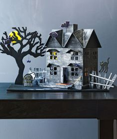 House repairs needed? Just kidding! Create this fun papier-mache haunted house before the spooks begin. #Halloween #fall #crafts