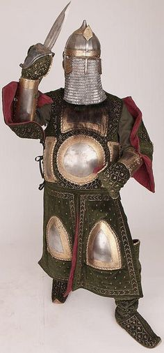 Indian chilta hazar masha (coat of a thousand nails), armored clothing made from layers of fabric faced with velvet and studded with numerous small brass nails, which were often gilded, and Ottoman style chichak helmet which was originally worn by cavalry of the Ottoman Empire, dastana (arm guards) and katar (push dagger). Fabric armor was very popular in India because metal became very hot under the Indian sun. This example has additional armor plates in the chest, arm and thigh areas.
