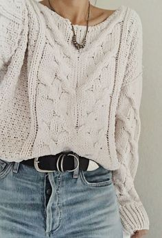 white cable knit sweater with denim
