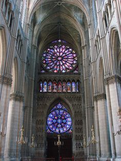 Nave of Reims Gothic cathedral, looking west. The upper rose window is in Gothic architecture Rayonnant style.
