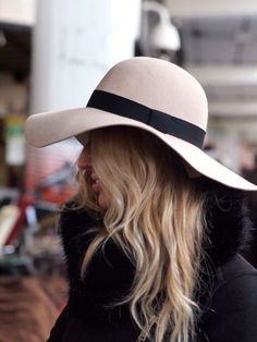 This hat has a nice wide brim which is elegantly, but not too floppy. It would protect your face well, and the contrasting band adds the final touch.