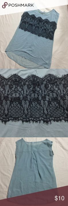 Women's dressy top Turquoise color top with black lace on front. Sheer back that is a little longer than the front. Good condition Studio Y Tops
