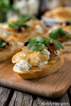 Onion Jam Crostini with Herbed Goat Cheese - A delicious, elegant appetizer that is easy to make and super delicious!