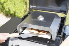 Portable pizza oven with spatula and pizza peel. Portable Pizza Oven, Pizza Oven Outdoor, Cute Apartment, Pizza Ovens, Camping Stove, Grilling, Bbq, Camping Ideas, Industrial Design