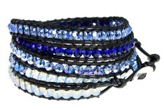 """39"""" Sparkling Ocean Blues Faceted Bead Leather Bracelet 5x Wrap in Gift Box. Black Leather Wrap Bracelet With Light and Dark Iridescent Blue & White Cloud Faceted Glass Beads. Quality Hand-crafted, Hand-sewn 39 Inch Long Leather Bracelet Wraps 5x Around on 6 to 7.5 Inch Wrists. Adjustable Loops & Button Closure. Arrives Ready To Give in Gift Box. Looks Great When Worn Alone - Or Combine With Other Bracelets and Bangles for the Latest Stack Bracelet Look. Two Of Our Wraps Can Be Buttoned..."""