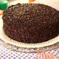 This delicious chocolate cake recipe is a two layer moist cake, with chocolate ganache in the middle and a dark chocolate buttercream frosting on the outsides.  Cover this with chocolate cake sprinkles and you have a very beautiful cake for a special occasion.