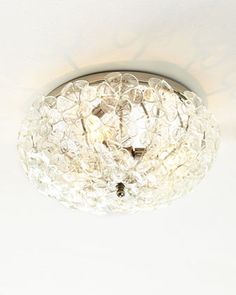 """Glass Flower Ceiling Fixture at Horchow. $450 17""""Dia. x 8""""T; canopy, 12""""Dia."""