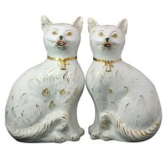 Pair of Scottish Pottery Figures of Seated Cats with Gold Collars, circa 1880  | From a unique collection of antique and modern pottery at http://www.1stdibs.com/furniture/dining-entertaining/pottery/