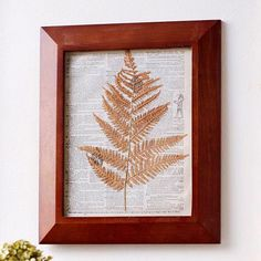 Framed for Fall  -- A simple pressed fern branch makes a seasonal art statement. Place a dry (but not brittle) fern branch between layers of newspaper, then top with several heavy books to press. Glue photocopies of pages from old books or newspapers to the backing of a picture frame. Decoupage the pressed branch to the page background and place in the picture frame, then hang your work of art.