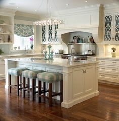 Kitchen island, love the idea of having people in the kitchen while you are cooking. You do not have te miss anything