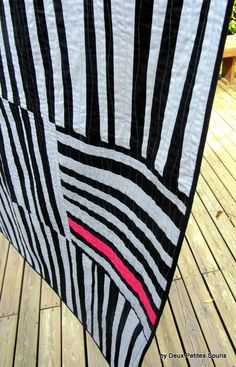 Modern Quilt in pink and black and gray, inspired by African American quilts. $400.00, via Etsy.