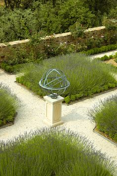 Armillary sphere in a garden by David Harber, via Flickr