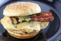Here is a copycat recipe for the Chicken Bacon Swiss Sandwich from Arby?s restaurant. This sandwich is loaded with fried chicken, Swiss cheese, peppered bacon and honey mustard sauce. The chicken is dipped in a seasoned flour mixture and then fried. Crispy Chicken, Chicken Bacon, Chicken Sandwich, Chicken Recipes, Bourbon Chicken, Chicken Ideas, Healthy Chicken, Fried Chicken, Arby's Recipe