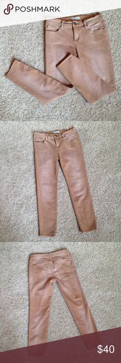 Free People Skinny Jeans Size 27 Tan & Super Soft These skinny jeans from Free People are gorgeous! Made of 53% cotton, 23% rayon, 22% polyester and 2% spandex give these pants a super soft and stretchy feel for the perfect fit. Pretty button details with convenient pockets. Excellent condition with one small reddish stain on the back waistband (pictured). Get these today!!! Free People Jeans Skinny
