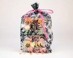 A bag of our lovely Jewelry Tarts!  There is a hidden jewel inside every bag of lovely soy wax tarts!