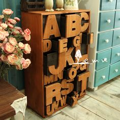 ABCs on the drawers--sooooo neat