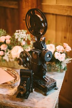 Vintage camera and movie projector from Vintage Ambiance accent this Sequim Fern Hollow wedding | Nickel Images