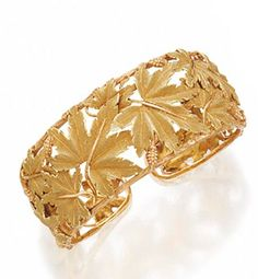 18 KARAT GOLD BANGLE-BRACELET, BUCCELLATI. The cuff with one hinged side decorated with an all-around  pattern of  maple leaves and pinecones, gross weight approximately 32 dwts., signed M. Buccellati. With fitted box stamped M. Buccellati.