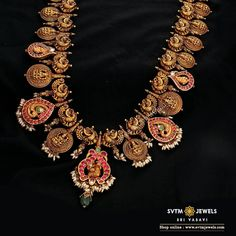 Make your wedding a fest with this gold long necklace beautified by the Lakshmi pattern studded with ruby, uncut diamond, and emerald stones. Gold Jewellery Design, Gold Jewelry, Gold Necklace, Bridal Jewelry, Jewellery Earrings, Antique Jewellery, Unique Earrings, Collar Necklace, Necklace Set