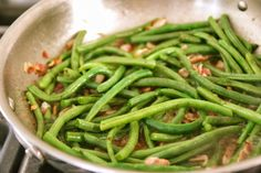Bacon Braised Green Beans 1 pound of green beans 4 pieces of bacon, diced 1/2 cup of onion, diced 1 cup of chicken stock sea salt & cracked pepper