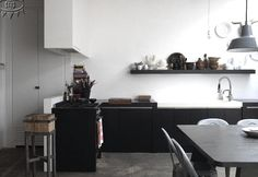Mix of modern black and white with industrial features.  Lotta Agaton: INTERIORS