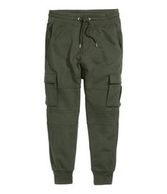 Sweatpants with an elasticized drawstring waistband, dropped gusset, mock fly, and ribbed hems. Side pockets, leg pockets, and one back pocket with flap and Velcro fastener.