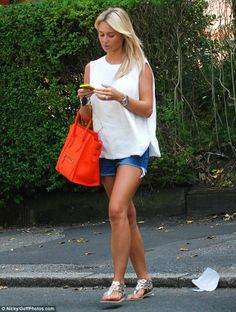 Flaunting her tan: Alex looked tanned after a recent family trip to Portugal with her daughters and husband Steven