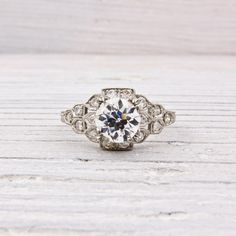 .99 Old European Cut Diamond Engagement Ring  $8,400.00    ADD TO CART  Set in PLATINUM and centered with a GIA certified .99 CARAT old european cut diamond with G color and SI1 clarity. Center stone is accented with single cut diamonds. Size 6*    *can be sized.    Circa 1925