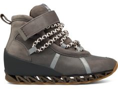 Bernhard Willhelm presents a grey ankle-high lace-up sneaker  with a strap made of nubuck leather. Its padded uppers provide protection and a voluminous look.