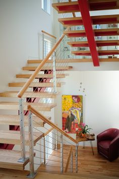 Beautiful open riser wooden staircase with a cable railing system. Stair Railing, Stairs, Cable Railing Systems, Wooden Staircases, Staircase Design, Wrought Iron, Contemporary, Modern, Interior And Exterior