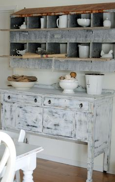 Love the old metal chicken coop as cubbies. Can't go wrong with milk glass.