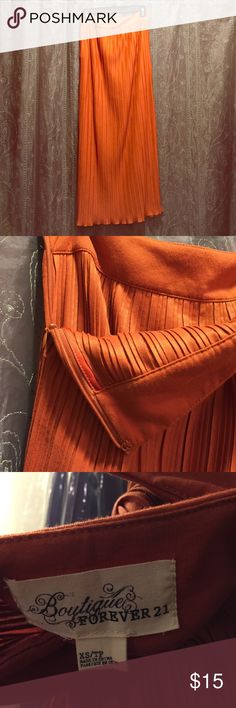 Full length orange skirt Full length orange pleated skirt. 100% polyester, hand wash, line dry. Only worn once, like new!!! Forever 21 Skirts