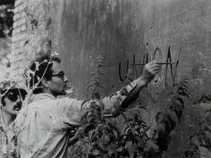 Godard painting on the set ofMasculin Feminin, 1966