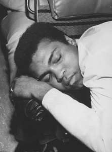 Muhammad Ali takes a nap while on a bus trip from Seattle to Vancouver, before his exhibition sparring at the Pacific Coliseum in Muhammad Ali Fights, Muhammad Ali Boxing, Sting Like A Bee, Hometown Heroes, George Foreman, Sport Icon, Dc Comics Characters, Black Pride, World Of Sports