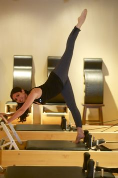 Taylor Lamanna Pilates. Balanced Body Pilates On- Site educator. Arabesque on the Balanced Body Studio Reformer.