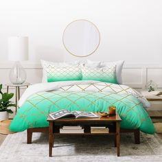 Leah Flores Turquoise and Gold Geometric Duvet Cover | Deny Designs